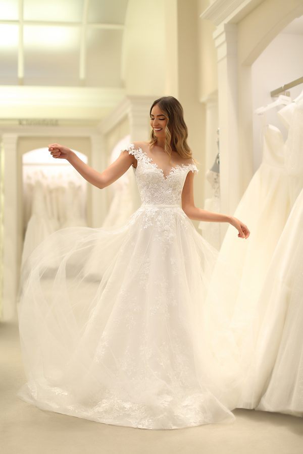 Off The Shoulder Bateau Neckline A-line Lace Wedding Dress With Overskirt by Michelle Roth - Image 1