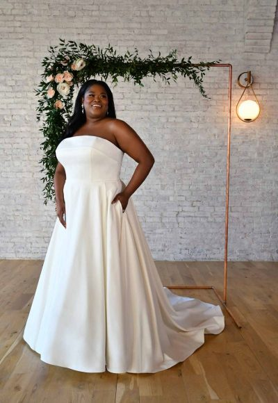 SIMPLE STRAPLESS PLUS-SIZE WEDDING GOWN WITH POCKETS by Stella York