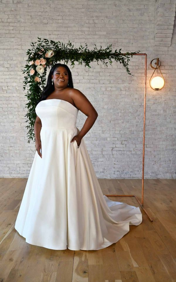SIMPLE STRAPLESS PLUS-SIZE WEDDING GOWN WITH POCKETS by Stella York - Image 1