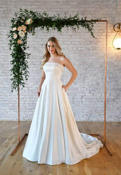 SIMPLE STRAPLESS WEDDING GOWN WITH POCKETS by Stella York