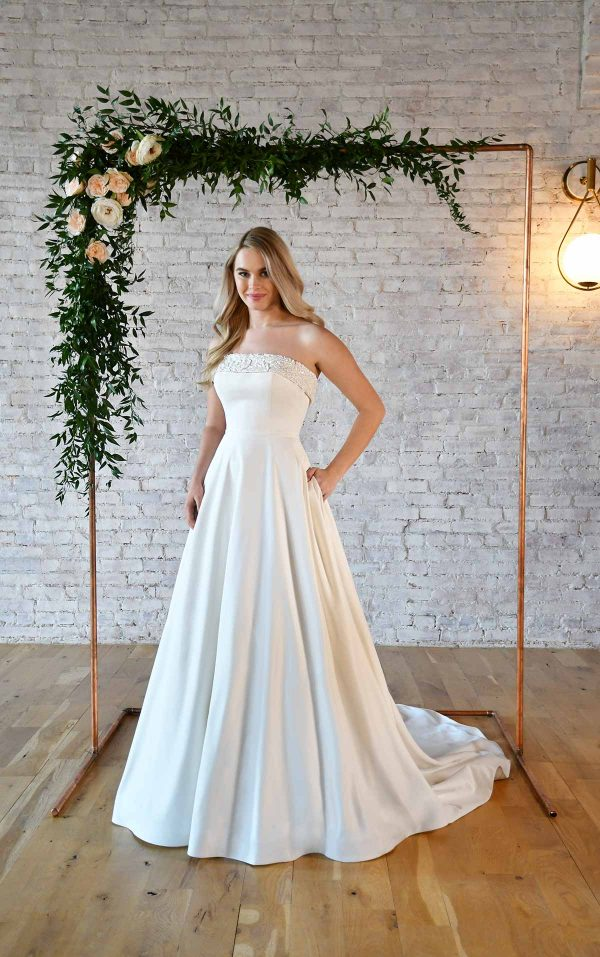 SIMPLE STRAPLESS WEDDING GOWN WITH POCKETS by Stella York - Image 1