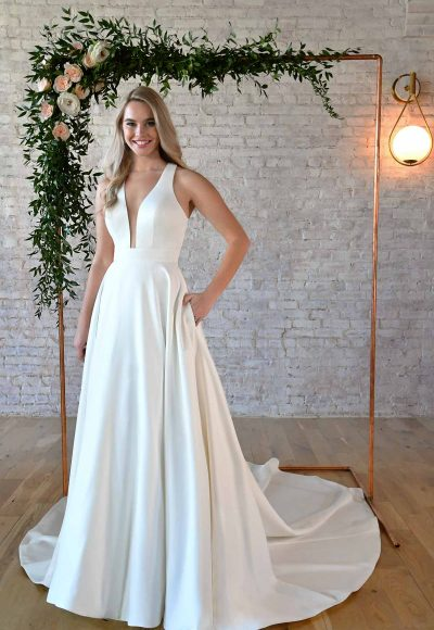 SIMPLE WEDDING GOWN WITH KEYHOLE BACK & BOW DETAIL by Stella York