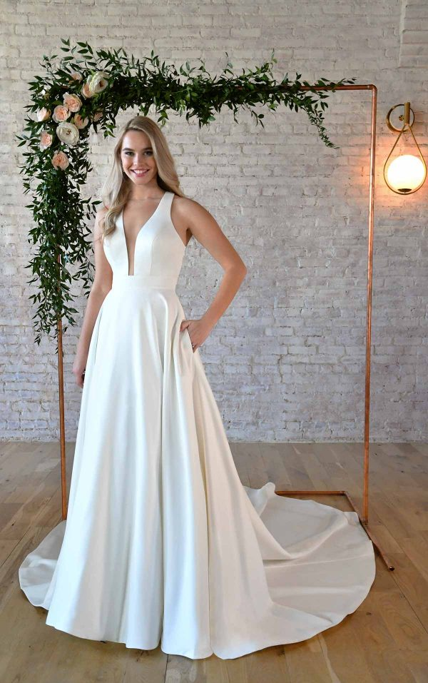 SIMPLE WEDDING GOWN WITH KEYHOLE BACK & BOW DETAIL by Stella York - Image 1